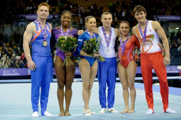 Medalists from the 2013 Glasgow World Cup. L-R Daniel Purvis (GBR), Elizabeth Price (USA), Larisa Iordache (ROU), Oleg Verniaiev (UKR), Vanessa Ferrari (ITL), Andrey Likhovitskiy (BLR).
