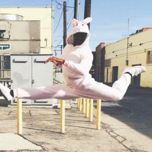 Emyre cole gymnast split leap bunny suit