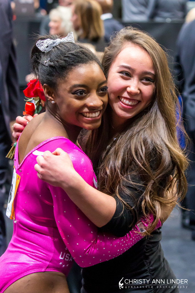 Simone Biles hugs Katelyn Ohashi after winning the 2015 American Cup.