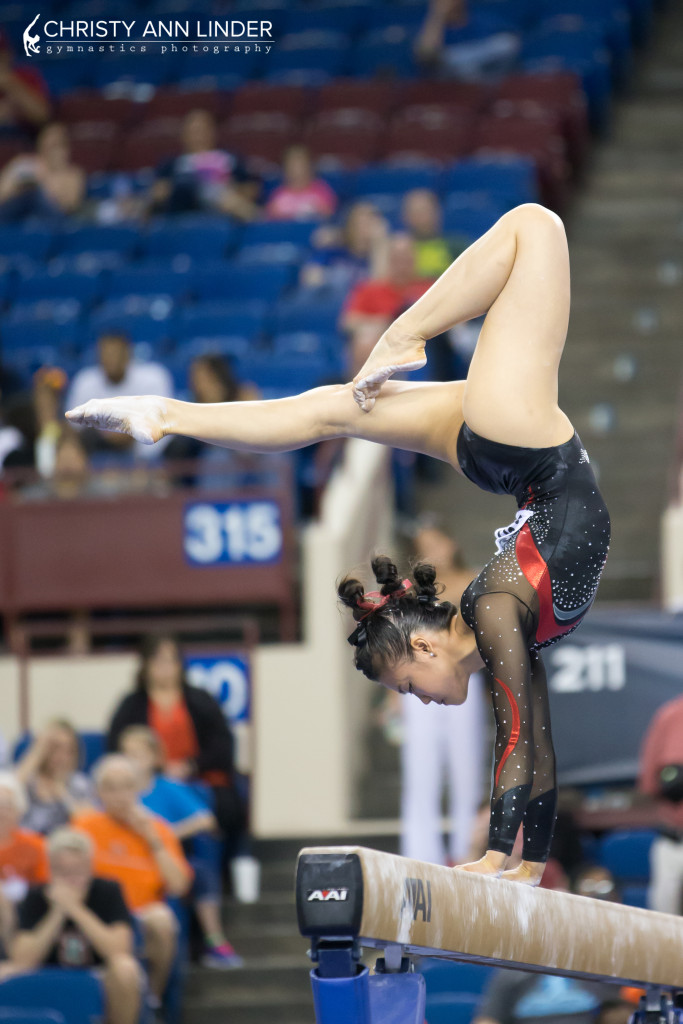 ivana hong handstand during beam finals at the 2015 ncaa championships