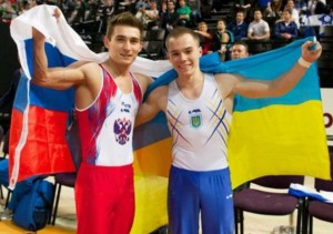 Oleg Verniaiev (UKR) David Belyavskiy (RUS) hugging and holding up the Russian and Ukranian flags