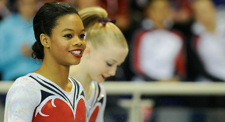 Gabby Douglas smiling at Jesolo competition Bailey Key in the background