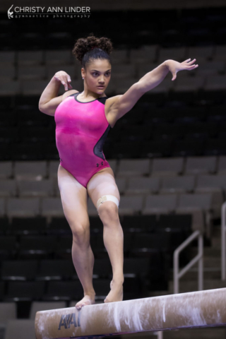 Laurie Hernandez stares the beam down